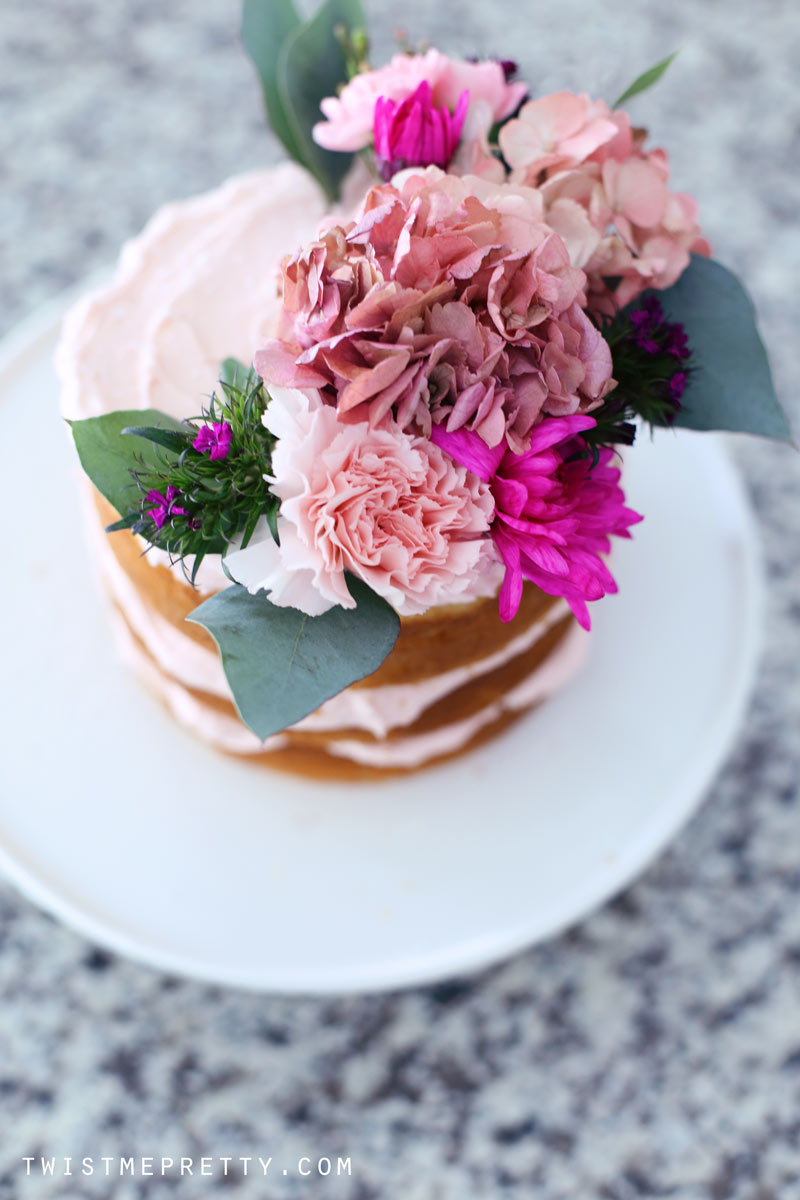 Easy naked cake tutorial for beginners twist me pretty flowers atop a naked cake twist me pretty mightylinksfo