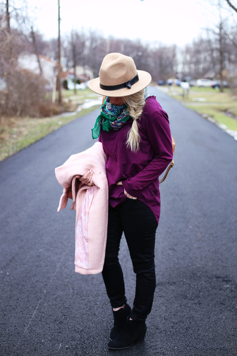 Pink coat, purple top and a fishtail braid.