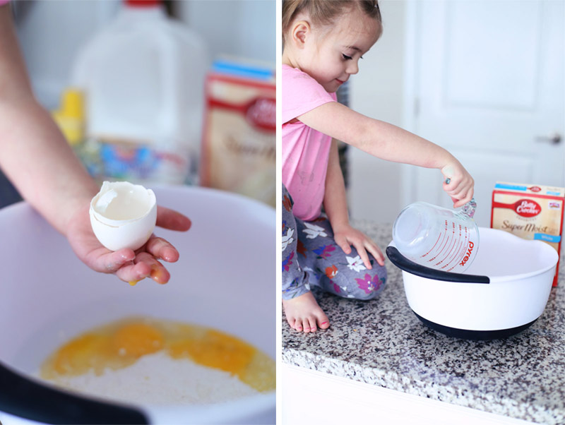 In a split photo, a girl bakes a cake. On the left, she cracks an egg into a bowl and on the right, she empties a jug into a bowl. Learn how to make this easy cake at Twist Me Pretty.