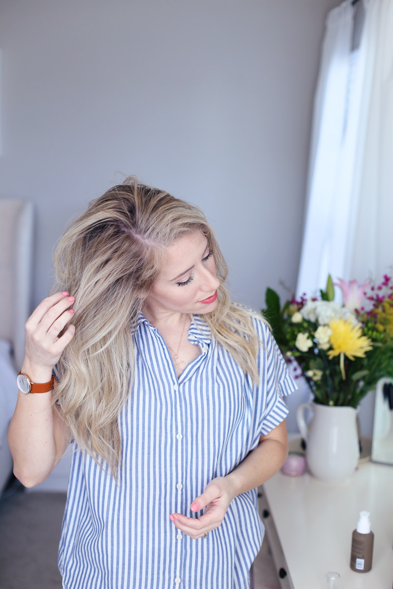 Abby applies Living proof's No Frizz Nourishing Tool to her hair
