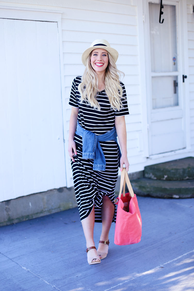 Fresh-faced and beautiful, Abby wears a striped dress, wicker hat, and denim jacket tied around her waist.