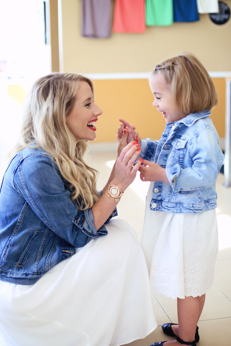 Special times. Savy and mom, Abby, wear matching white dresses and denim jackets.