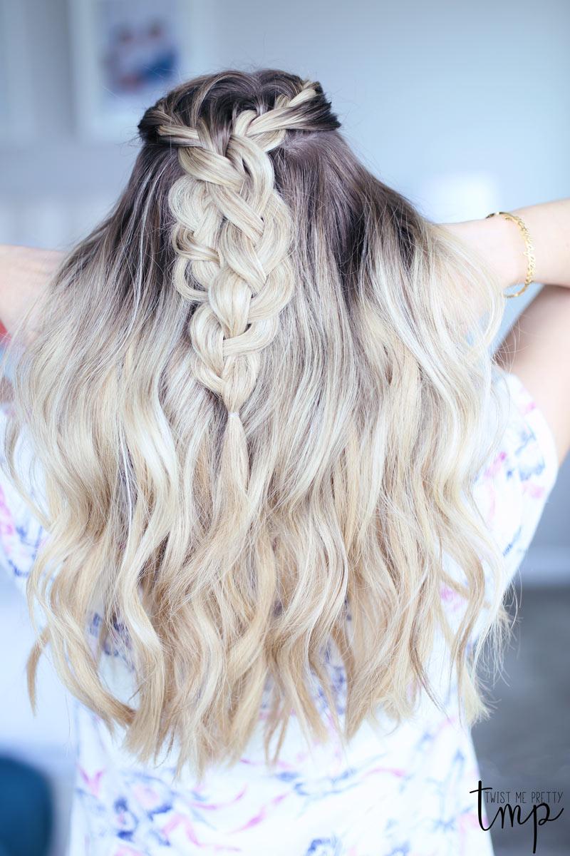 Wavy hair frames Abby's braids.