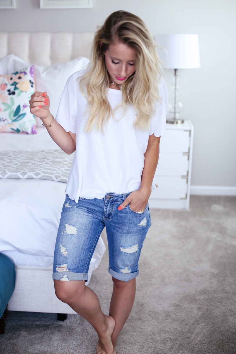 Soft curls are the perfect accompaniment to these distressed denim shorts and scalloped white top.