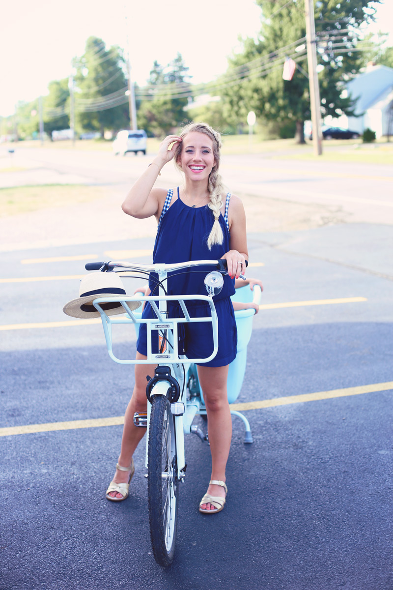 Abby pedals the Bucket Bike, wearing a blue romper.