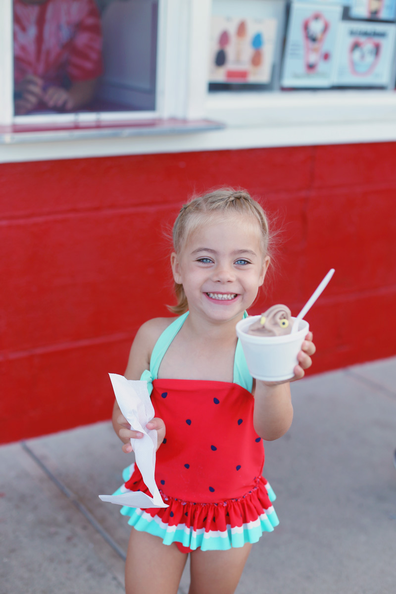 Savvy wears a watermelon swimsuit and shows off her chocolate ice cream.