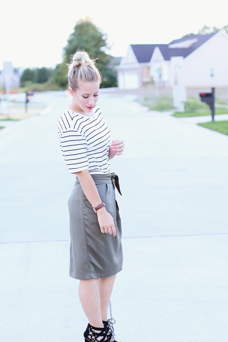 Abby wears a white top with black stripes and a gray skirt. Twist Me Pretty. Sunday style