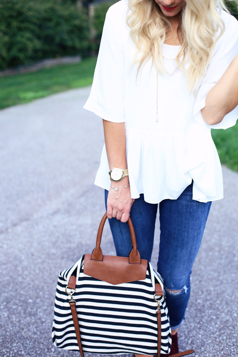 A woman shows off her handbag and accessories while she enjoys motherhood. Twist Me Pretty.