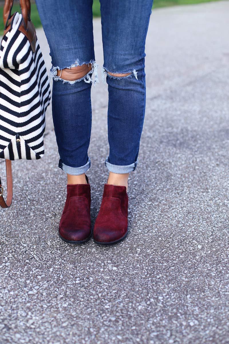 A woman's legs with her handbag and shoes. She enjoys motherhood. Twist Me Pretty.