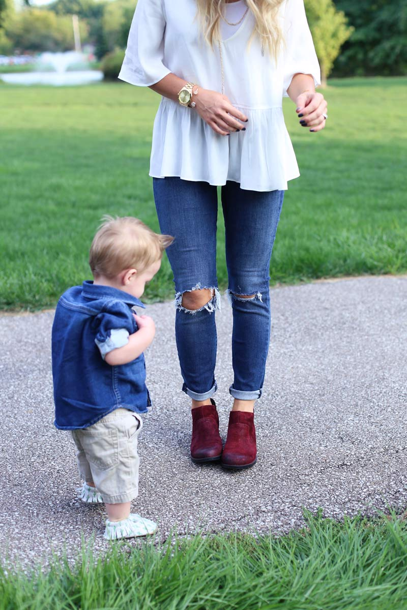 A little boy stands and looks at his mother's feet, as she enjoys motherhood. Twist Me Pretty.