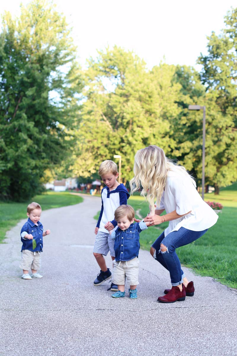 A mother and her three sons in a park. Enjoy motherhood. Twist Me Pretty.