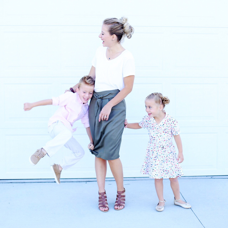 Twist me Pretty's Abby laughs as her children playfully grab her skirt. Sunday Style