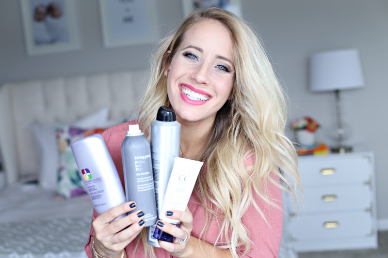 Displaying an array of products, a woman with gorgeous hair smiles at the camera. Twist Me Pretty.