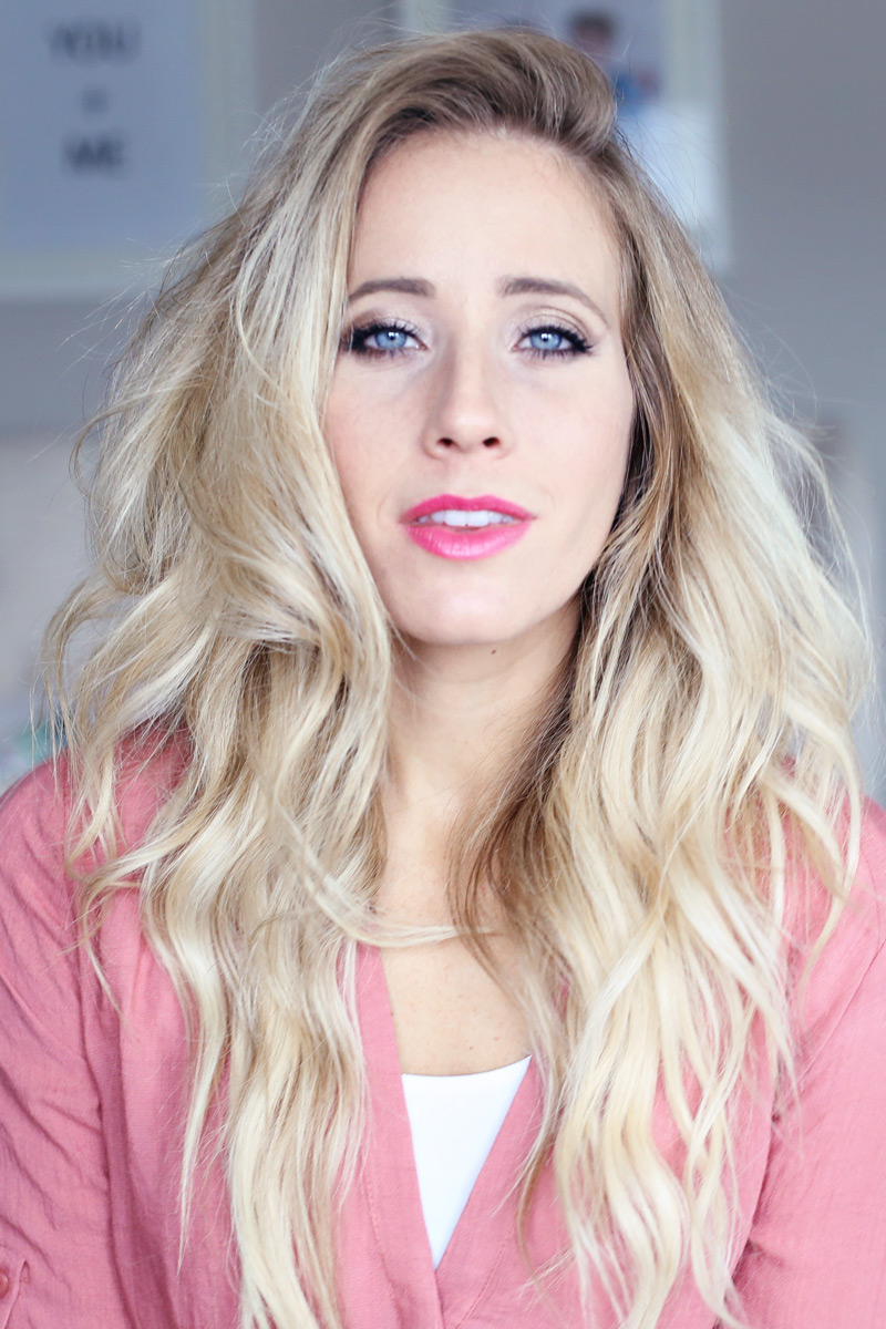 With tousled hair, a blonde woman gazes into the camera. You too can have gorgeous hair. Twist Me Pretty.