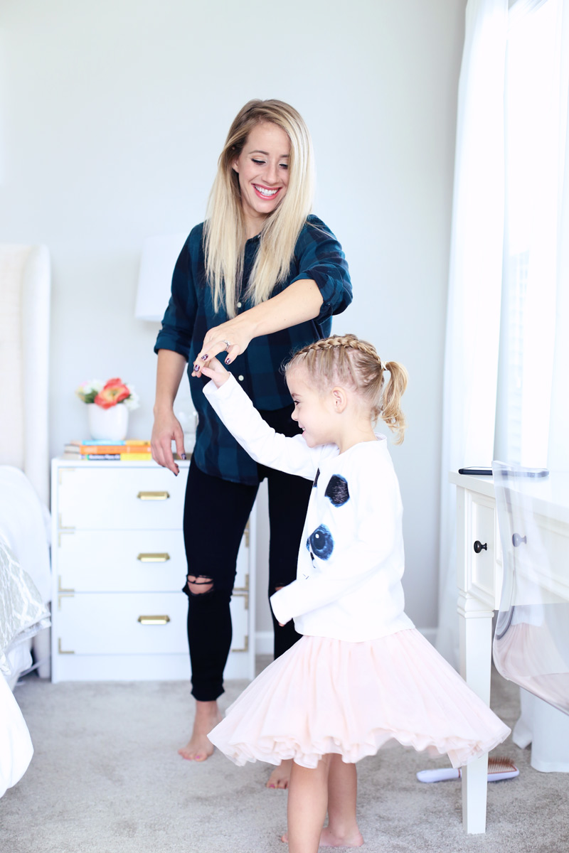 A mother and daughter grin as they dance together. Twist Me Pretty - Our Morning Routine.