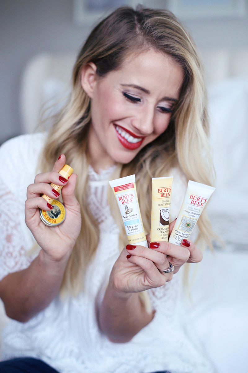 Abby from Twist Me Pretty smiles as she displays products from Burt's Bees' holiday gift sets!