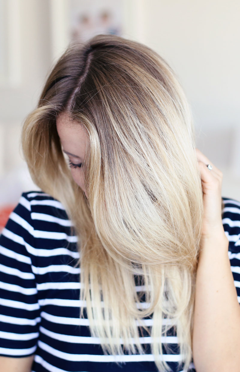 Volumnious, gorgeous hair... you can have it too! Find out how to dry your hair with a round brush at Twist Me Pretty.