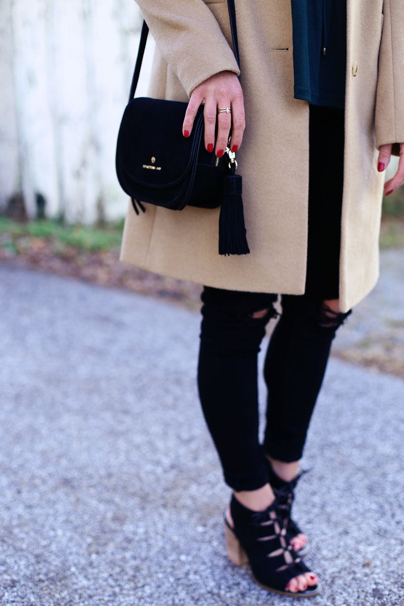 Abby's black bag, tan coat, black pants and wedge sandals pair flawlessly with her bell sleeves. Twist Me Pretty.