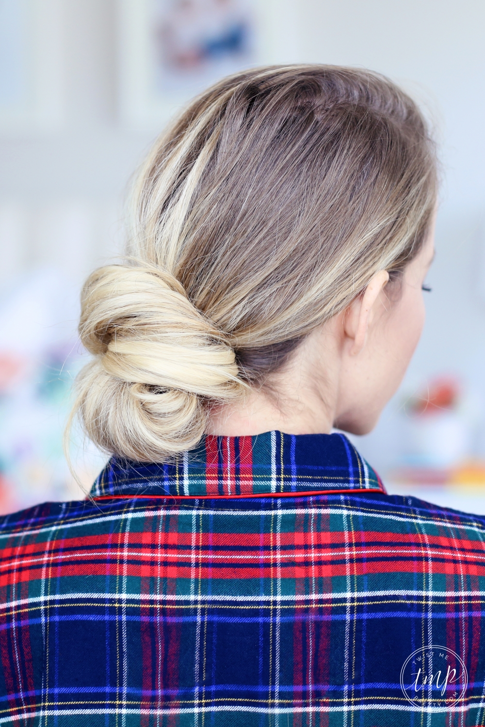 Twist Me Pretty's Abby sports a simple, classic low bun - a perfect hairstyle for Christmas morning.
