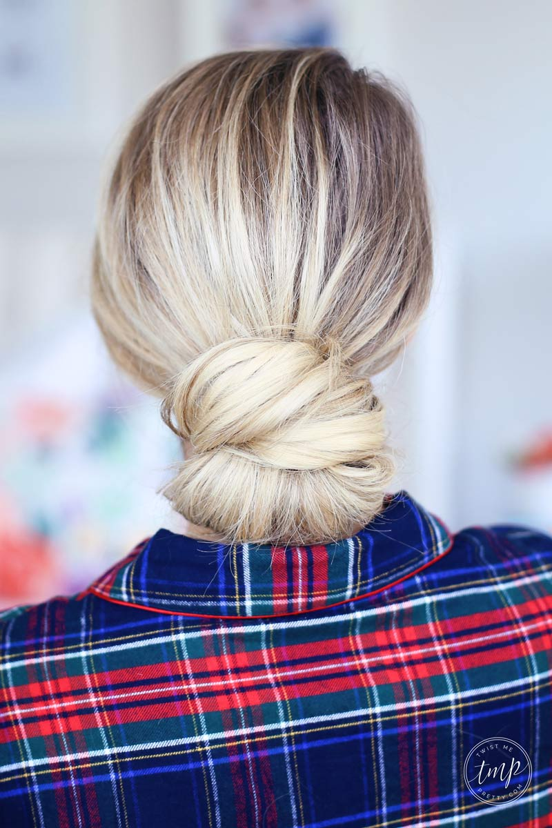 A neat low bun is the perfect Christmas morning hairstyle. Look fabulous this festive season with Twist Me Pretty.