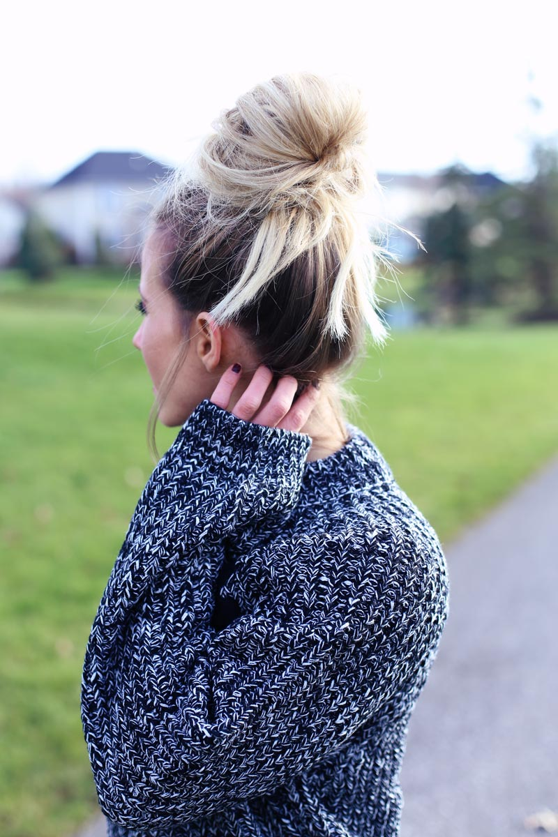 Comfortable, casual and chic - this big bun and oversized sweater look is perfect for the weekend.