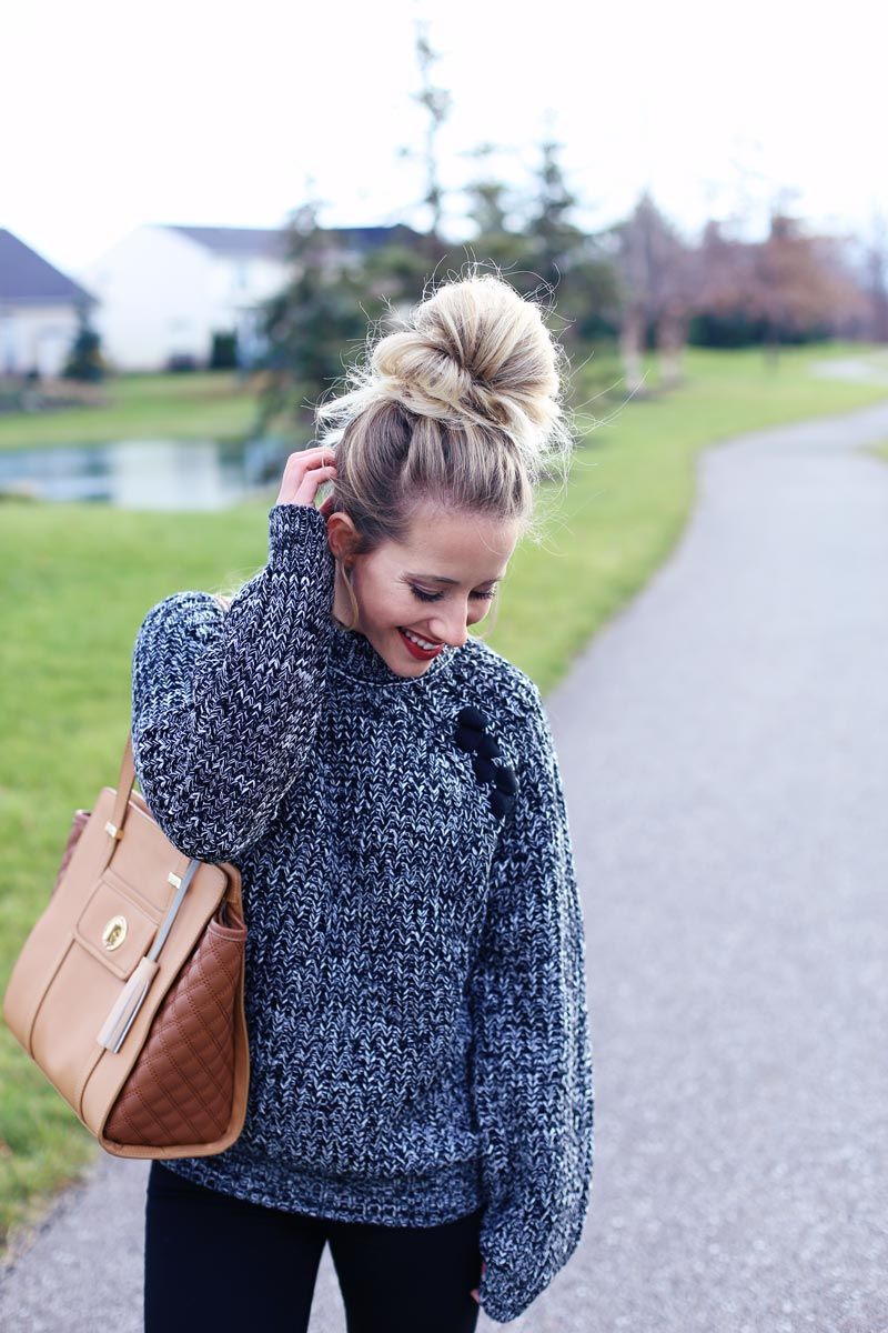 Big hair and big sweaters are a great pair.