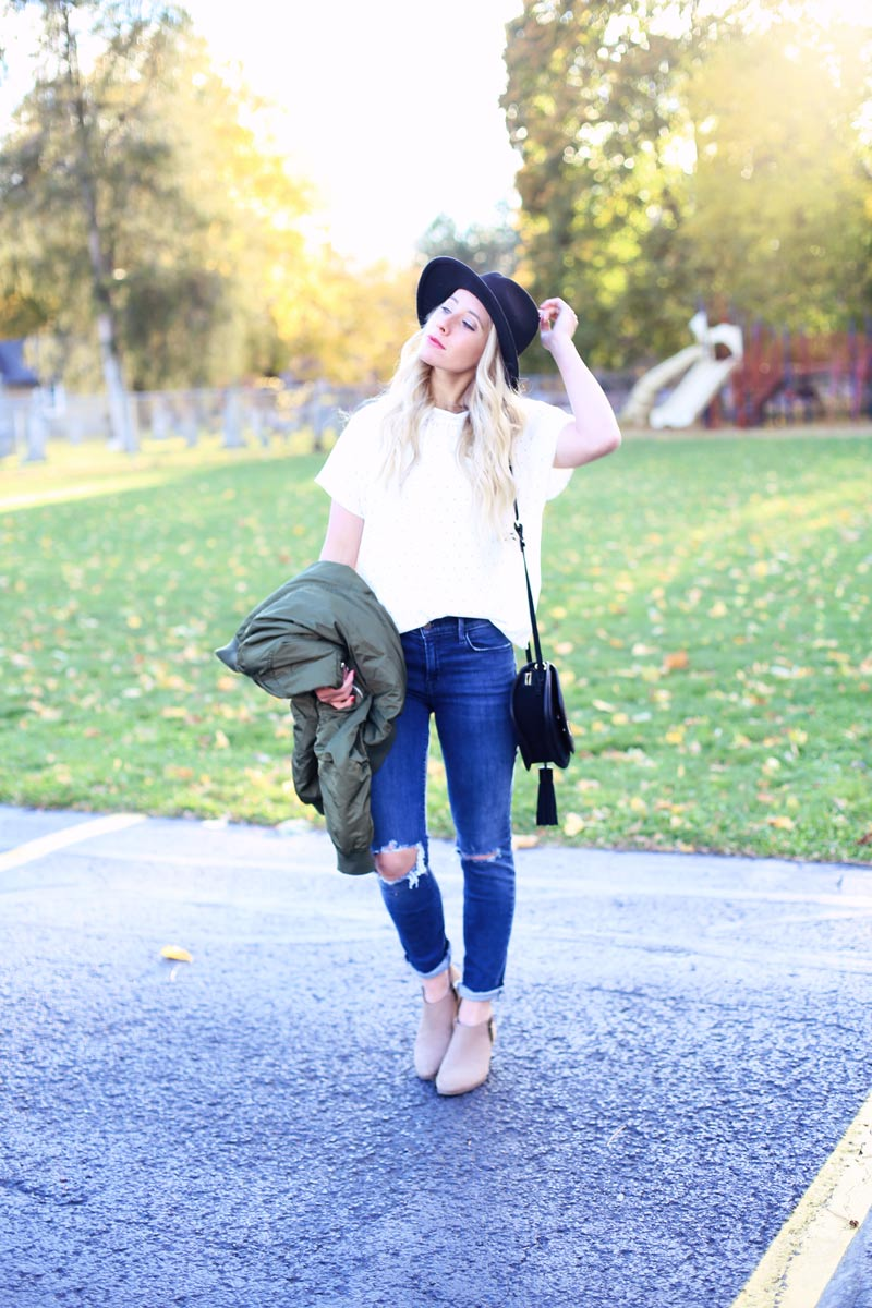 Casual yet chic - Abby wears ripped jeans and a collared shirt.