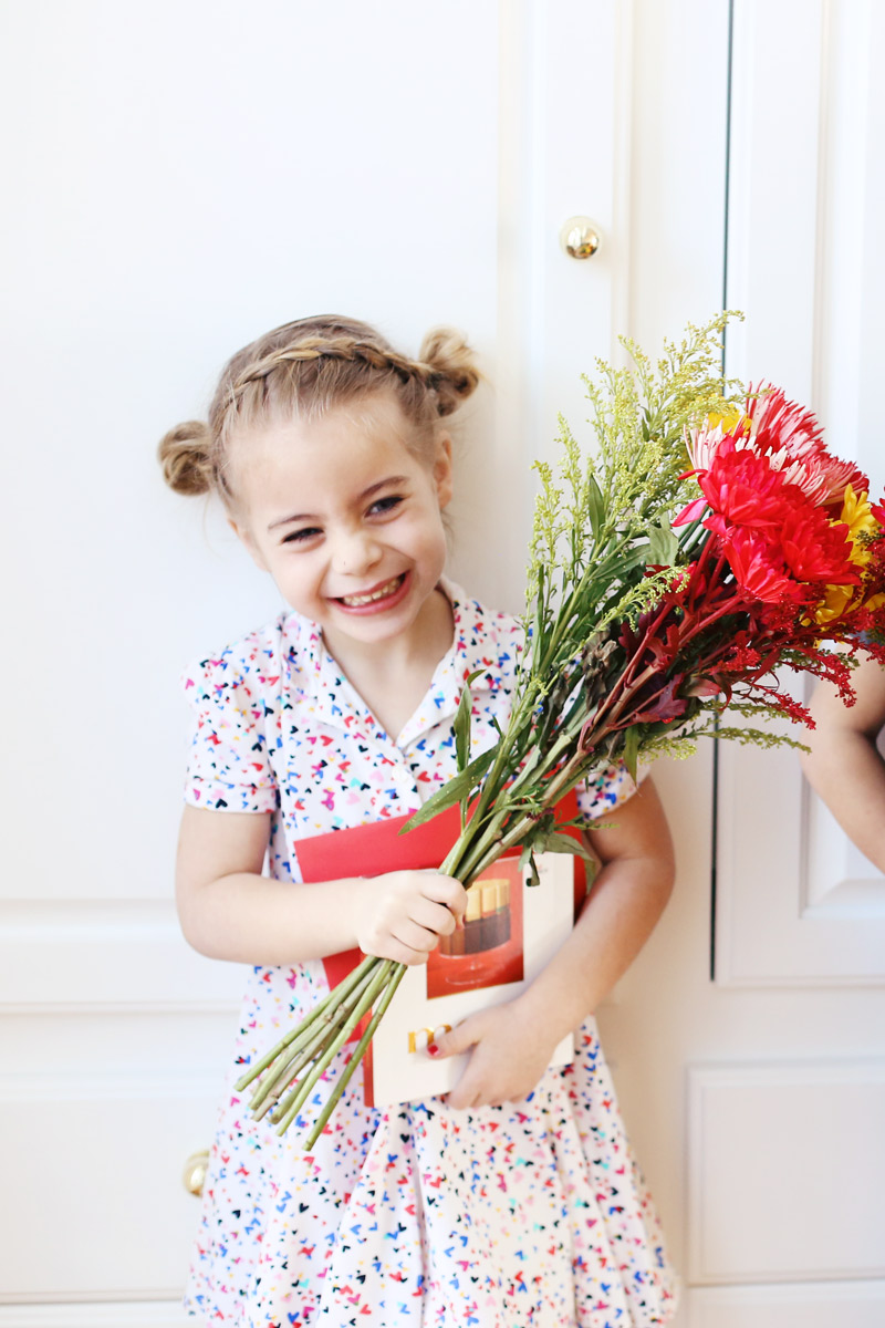 Savy is proud of the flowers and merci chocolates she'll give her teacher