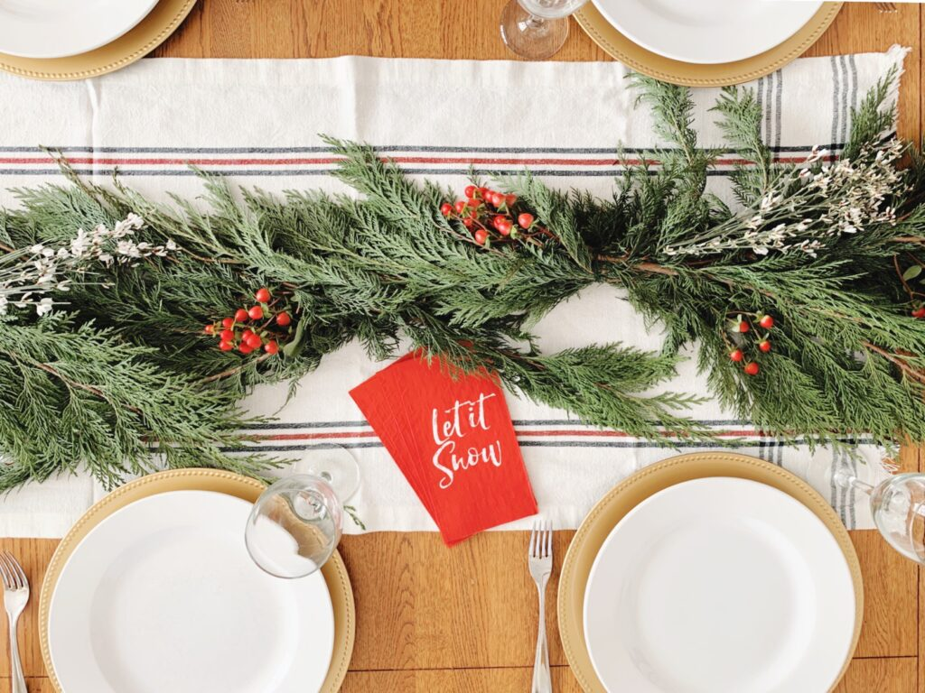 Incorporating a little bit of greenery to decorate your holiday table is an easy way to add a beautiful touch to any centerpiece.