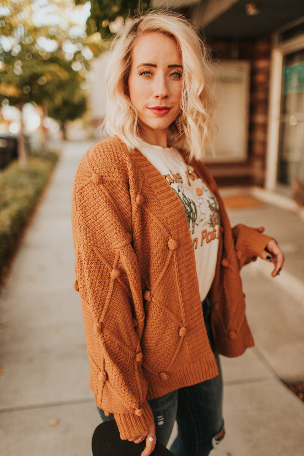 Love this sweater with the pom pom detail. Such warm tones perfect for fall and winter and anytime you need to be cozy!